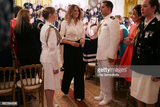S first lady Melania Trump leaves an event honoring military mothers on National Military Spouse Appreciation Day in the East Room at the White House...