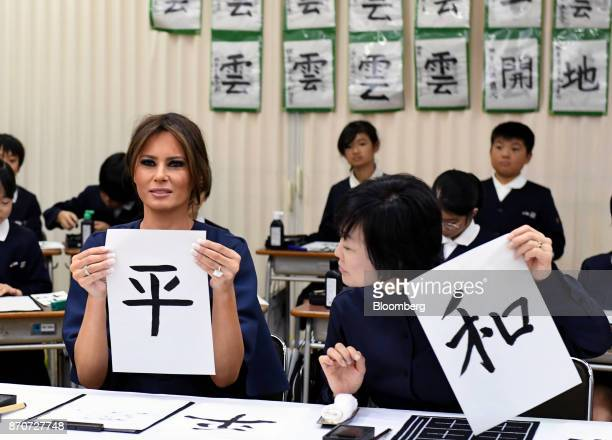 US First Lady Melania Trump left and Akie Abe wife of Japan's Prime Minister Shinzo Abe display pieces of paper that read 'Peace' in Kanji characters...