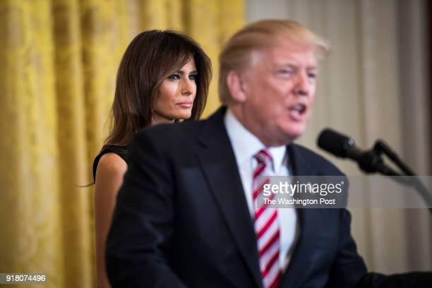 First lady Melania Trump listens as President Donald Trump speaks during a National African American History Month reception in the East Room of the...