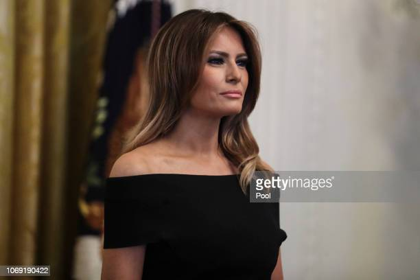 First lady Melania Trump listens as President Trump speaks during a Hanukkah reception in the East Room of the White House on December 6 2018 in...