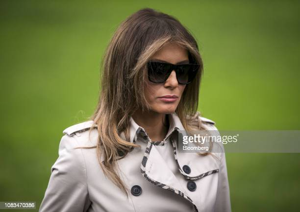 First Lady Melania Trump listens as U.S. President Donald Trump, not pictured, speaks to members of the media before boarding Marine One on the South...