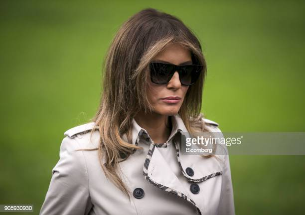 First Lady Melania Trump listens as US President Donald Trump not pictured speaks to members of the media before boarding Marine One on the South...