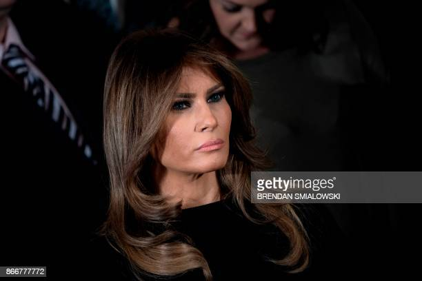 US first lady Melania Trump listens to the US president deliver remarks on combatting drug demand and the opioid crisis on October 26 2017 in the...