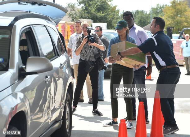 US First Lady Melania Trump loads supplies for Hurricane Harvey victims at the First Church of Pearland on September 2 in Pearland Texas / AFP PHOTO...