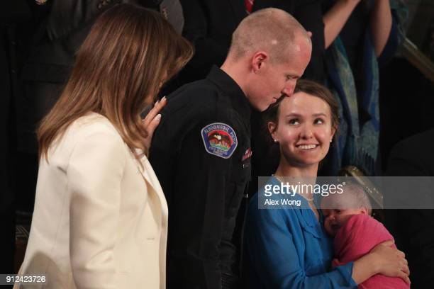 First lady Melania Trump looks on as Police officer Ryan Holets and his wife are acknowledged during the State of the Union address in the chamber of...