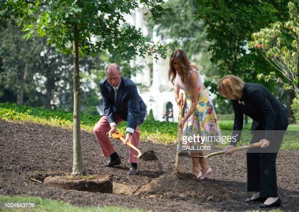 US First Lady Melania Trump participates in a tree planting ceremony alongside Mary Jean Eisenhower granddaughter of President Dwight Eisenhower and...
