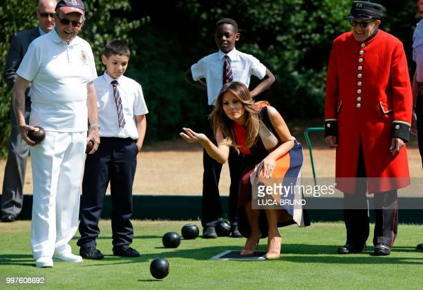 First Lady Melania Trump plays bowls accompanied by a Chelsea Pensioner as she visits the Royal Chelsea Hospital in London on July 13 2018 on the...