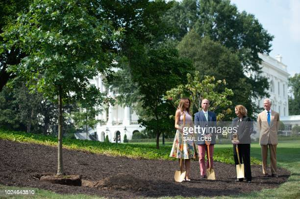 US First Lady Melania Trump poses for a photo alongside Mary Jean Eisenhower granddaughter of President Dwight Eisenhower and Richard Emory Gatchell...