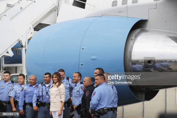 S first lady Melania Trump poses for photographs with US Border Patrol agents and McAllen police officers at McAllen Miller International Airport...