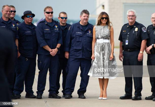 US First Lady Melania Trump poses with local police before boarding a military airplane prior to departure from Nashville International Airport in...