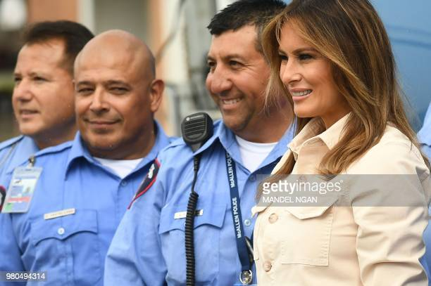First Lady Melania Trump poses with McAllen city police during a visit to the Luthern Social Services of the South's Upbring New Hope Children Center...