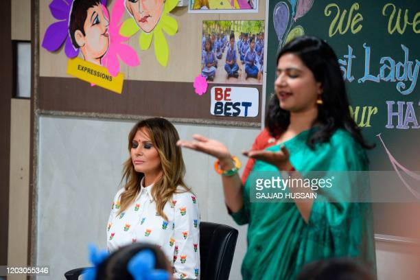 US First Lady Melania Trump practises meditation along with a teacher and students in a classroom during her visit at Sarvodaya CoEd Senior Secondary...