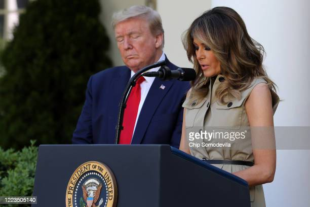 S first lady Melania Trump prays with President Donald Trump during a National Day of Prayer event in the Rose Garden at the White House May 07 2020...