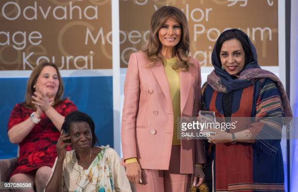 US First Lady Melania Trump presents a 2018 International Women of Courage Award to Roya Sadat of Afghanistan during the Award Ceremony at the State...