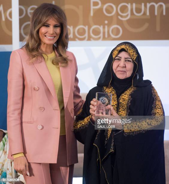 US First Lady Melania Trump presents a 2018 International Women of Courage Award to Aliyah Khalaf Saleh of Iraq during the Award Ceremony at the...