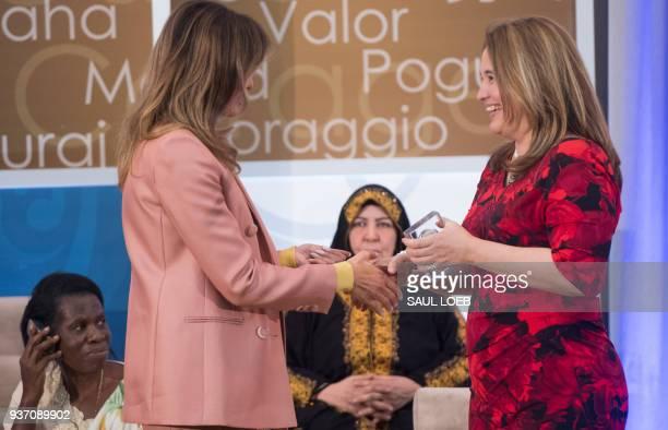 US First Lady Melania Trump presents a 2018 International Women of Courage Award to Dr Julissa Villanueva of Honduras during the Award Ceremony at...