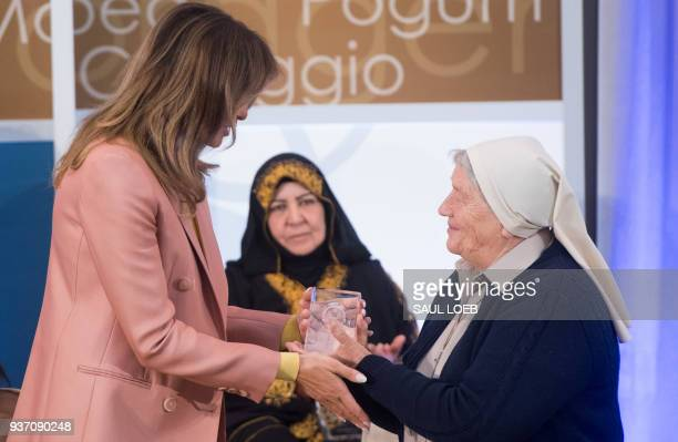 US First Lady Melania Trump presents a 2018 International Women of Courage Award to Sister Maria Elena Berini of Italy during the Award Ceremony at...