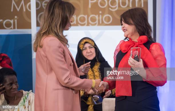 US First Lady Melania Trump presents a 2018 International Women of Courage Award to Aiman Umarova of Kazakhstan during the Award Ceremony at the...