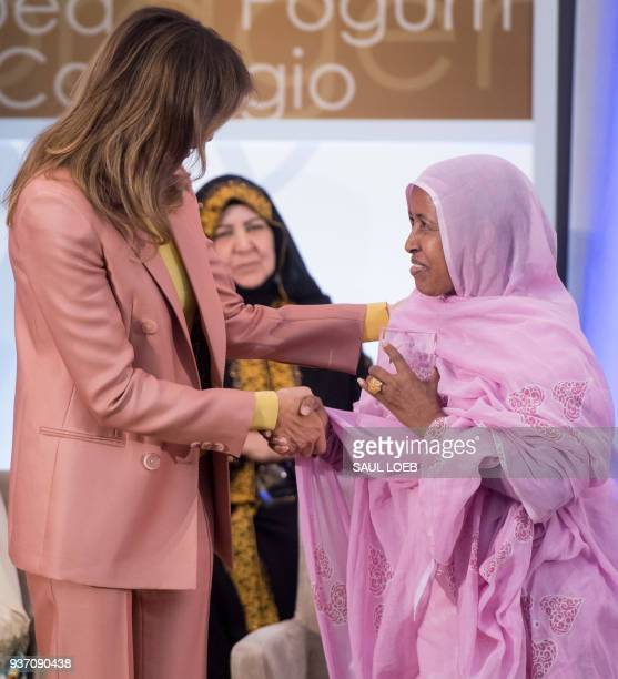 US First Lady Melania Trump presents a 2018 International Women of Courage Award to L'Malouma Said of Mauritania during the Award Ceremony at the...