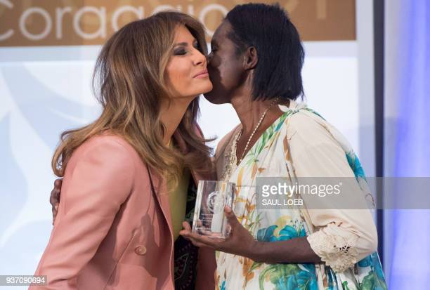 US First Lady Melania Trump presents a 2018 International Women of Courage Award to Godelieve Mukasarasi of Rwanda during the Award Ceremony at the...