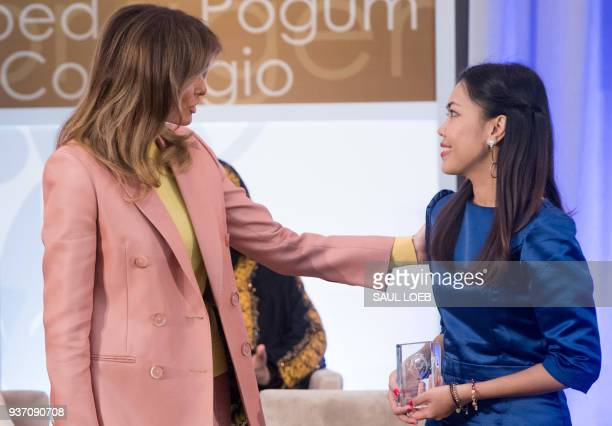 US First Lady Melania Trump presents a 2018 International Women of Courage Award to Sirikan Charoensiri of Thailand during the Award Ceremony at the...