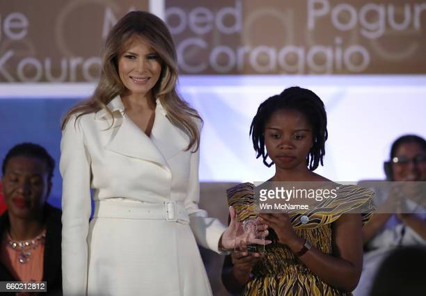 S first lady Melania Trump presents the 2017 Secretary of State's International Women of Courage Award to Rebecca Kabugho of the Democratic Republic...