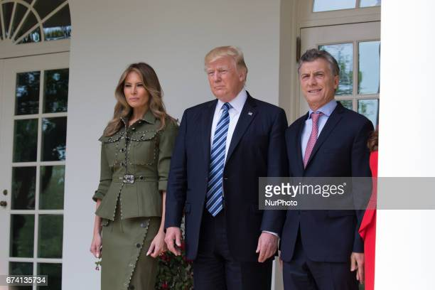 First Lady Melania Trump President Donald Trump and Argentina's President Mauricio Macri stop to pose for a photo in the West Wing Colonnade of the...