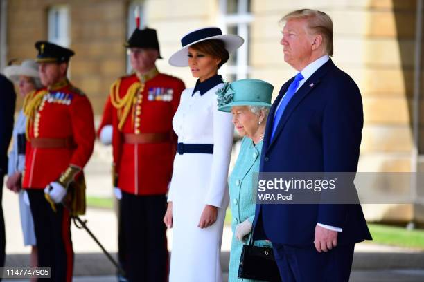 First Lady Melania Trump Queen Elizabeth II and US President Donald Trump during the Ceremonial Welcome at Buckingham Palace on the first day of the...