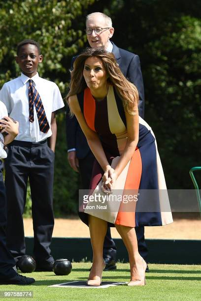 First Lady, Melania Trump, reacts as she tries her hand at bowls whilst meeting British Army veterans, known as Chelsea Pensioners, at Royal Hospital...