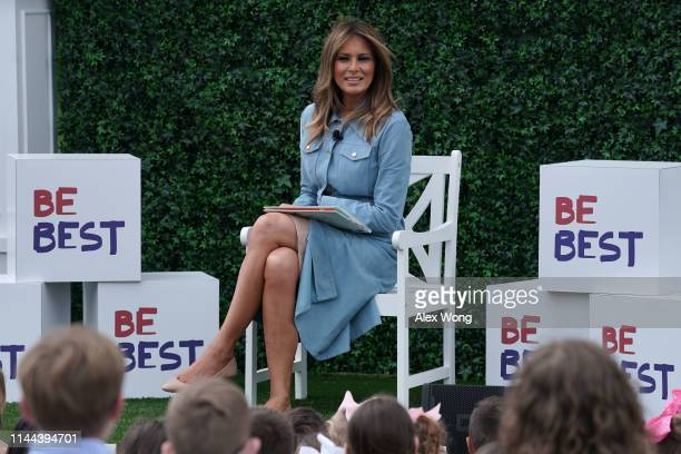 S first lady Melania Trump reads a story book to children during the 141st Easter Egg Roll on the South Lawn of the White House April 22 2019 in...