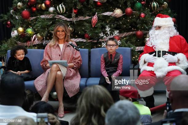 S first lady Melania Trump reads aloud the story 'Oliver the Ornament' to children patients as patient escorts Tearrianna CookeStarkey and Nathan...