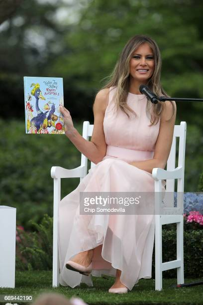S first lady Melania Trump reads 'Party Animals' by Kathy Lee Gifford during the 139th Easter Egg Roll on the South Lawn of the White House April 17...
