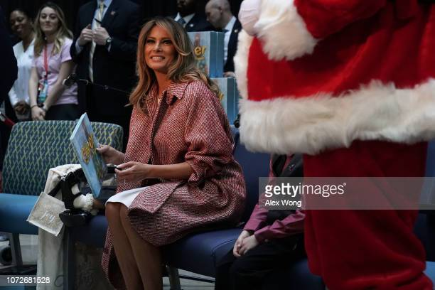 S first lady Melania Trump reads the story 'Oliver the Ornament' to children patients during a visit to the Children's National Hospital December 13...