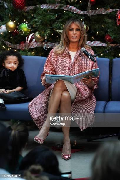 S first lady Melania Trump reads the story 'Oliver the Ornament' to children patients as patient escort Tearrianna CookeStarkey listens during a...