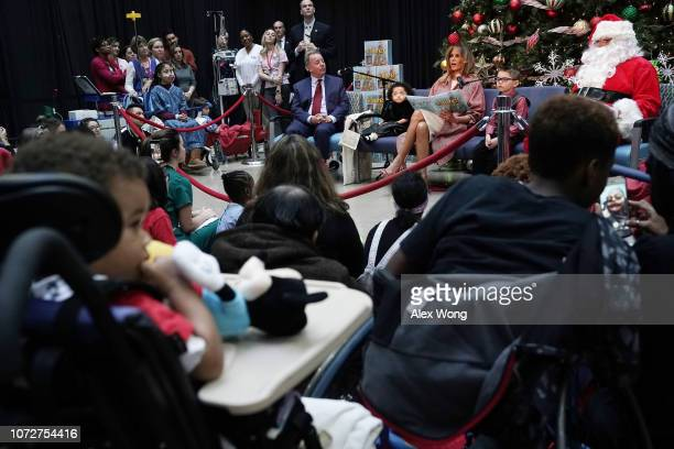 S first lady Melania Trump reads the story 'Oliver the Ornament' to children patients as author Todd Zimmerman patient escorts Tearrianna...