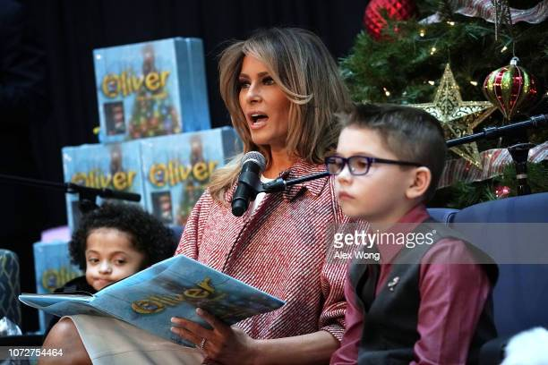 S first lady Melania Trump reads the story 'Oliver the Ornament' to children patients as patient escorts Tearrianna CookeStarkey and Nathan Simm...