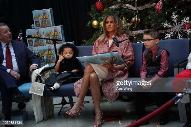 S first lady Melania Trump reads the story 'Oliver the Ornament' to young patients as author Todd Zimmerman patient escorts Tearrianna CookeStarkey...