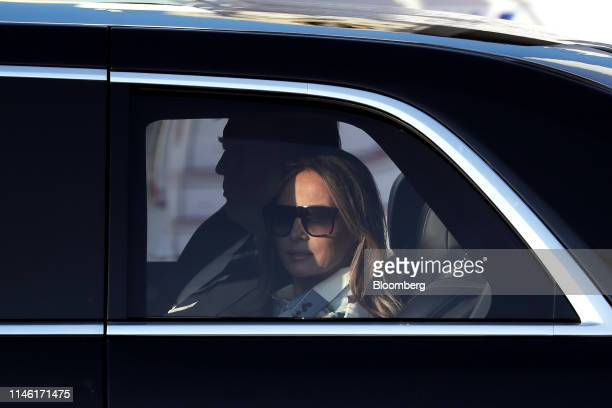 US First Lady Melania Trump right and US President Donald Trump sit inside their motorcade as they leave Haneda Airport in Tokyo Japan on Saturday...