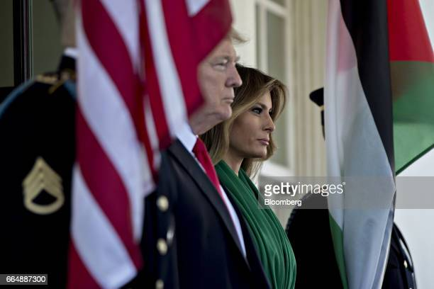 US First Lady Melania Trump right and US President Donald Trump stand as they wait to greet King Abdullah II of Jordan and Rania AlAbdullah Queen of...
