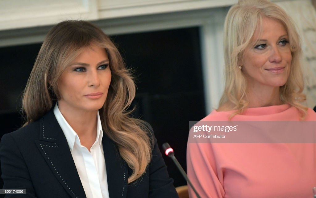 US First Lady Melania Trump (L), seated next to Counselor to the President Kellyanne Conway, speaks during a round table discussion on opioid abuse in the State Dining Room of the White House on September 28, 2017 in Washington, DC. /