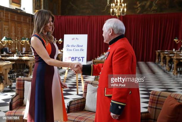 """First Lady Melania Trump shakes hands with a British military veteran known as a """"Chelsea Pensioner"""" at Royal Hospital Chelsea on July 13, 2018 in..."""