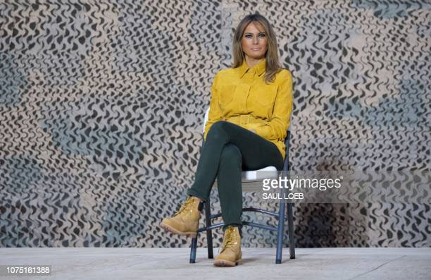 First Lady Melania Trump sits onstage as US President Donald Trump speaks to members of the US military during an unannounced trip to Al Asad Air...