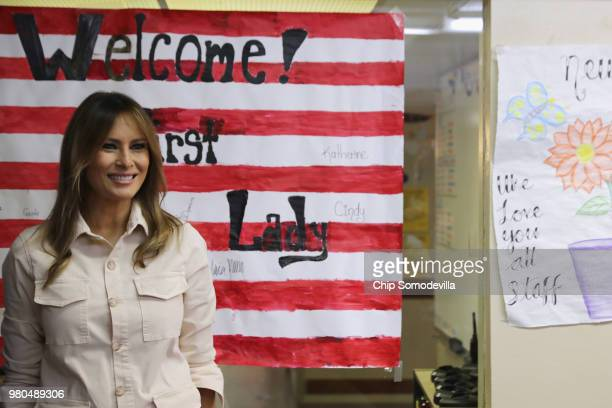 S first lady Melania Trump smiles after signing a welcome poster made for her after a round table discussion with doctors and social workers at the...