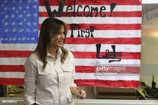 US first lady Melania Trump smiles after signing a welcome poster made for her after a round table discussion with doctors and social workers at the...