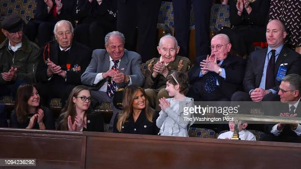 First lady Melania Trump smiles towards Grace Eline as she is applauded after President Donald J Trump recognized her during his State of the Union...
