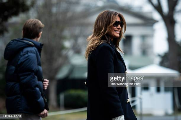 First Lady Melania Trump son Barron Trump and President Donald J Trump walk to Marine One to depart from the South Lawn at the White House on Friday...