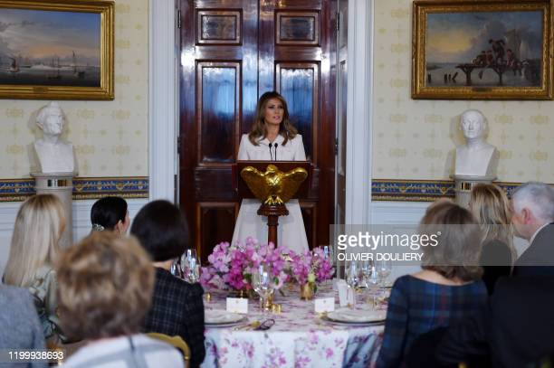 First Lady Melania Trump speaks at a luncheon for governors spouses in the Blue Room at the White House on February 10 2020 in Washington DC