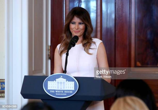First Lady Melania Trump speaks at a luncheon for governors spouses in the Blue Room at the White House on February 26 2018 in Washington DC The...