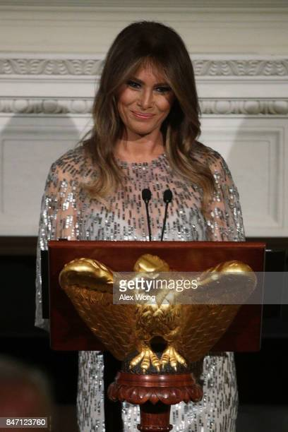 S first lady Melania Trump speaks during a reception at the State Dining Room of the White House September 14 2017 in Washington DC President Trump...
