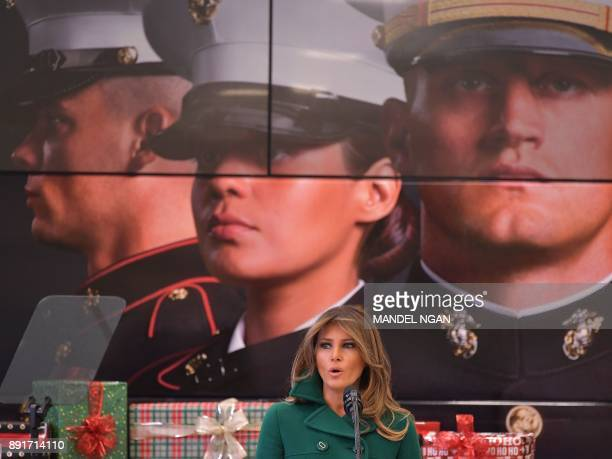 US First Lady Melania Trump speaks during a visit to Joint Base AnacostiaBolling in Washington DC on December 13 2017 NGAN